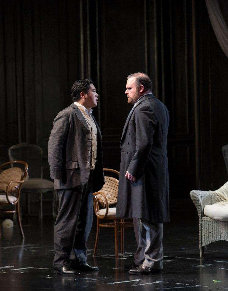 WNO La traviata - Kang Wang (Alfredo) and Roland Wood (Giorgio Germont). Photo credit Betina Skovbro - 3489a
