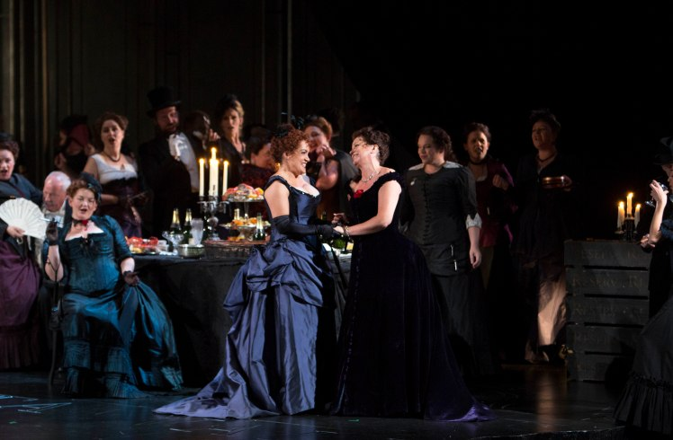 WNO La traviata - Rebecca Afonwy-Jones (Flora), Linda Richardson (Violetta) and WNO Chorus. Photo credit Betina Skovbro - 2820a